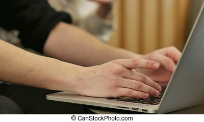 Hands touch typing on a laptop keyboard. Close up. Slow...