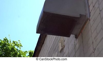 vent pipe is in a white brick building.