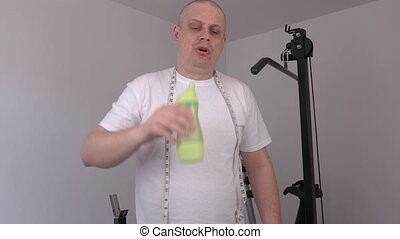 Tired man with water bottle and measure tape after workout