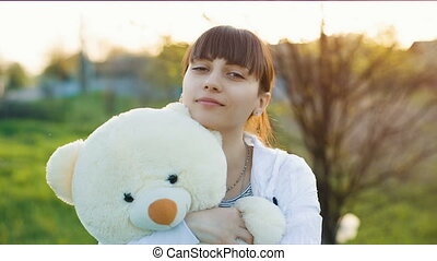 Woman with white bear - Happy woman with a teddy bear on...