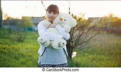 Woman with teddy bear - Happy woman with a teddy bear on...