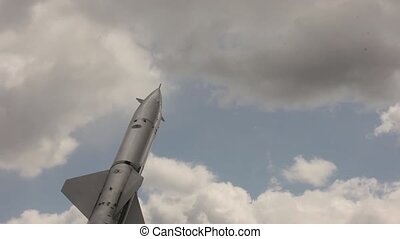 anti-aircraft missiles on a sky background. military...