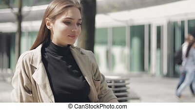Stylish young woman posing outside - Young woman wearing...