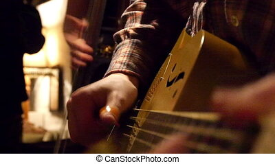 Close-up of a live band playing. - Close-up of the...