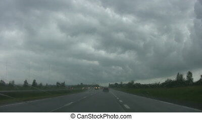 Driving into rainstorm - Highway driving with heavy rain on...
