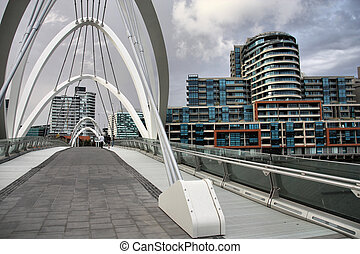 Melbourne - Modern footbridge and office buildings in...