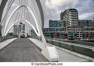 Melbourne - Modern footbridge and office buildings in...