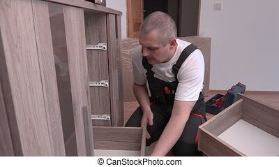 Worker fixing drawers