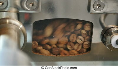 Roastering process in special machine. Close up. Slow...