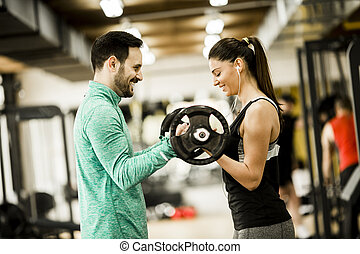 Woman and trainer in the gym