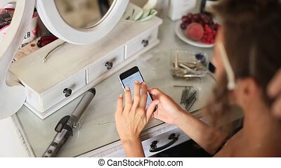 Telephone in female hands. Girl enjoys smartphone -...