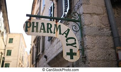 "The label ""Pharmacy"" on the wall. Pharmacy signboard on the..."