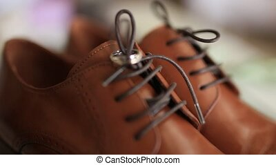 Wedding rings on a brown men's shoes. Wedding jewelry.