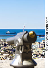 Genoa, Italy - Closeup of touristic monocular for view at...