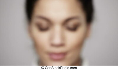 Zoom in closeup of young african ethnicity woman opening her...