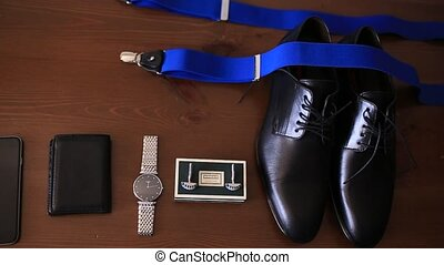 Cufflinks, watches, black shoes, blue suspenders Wedding...