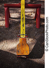 Part of a Yellow Teeter - Details of playground in city...