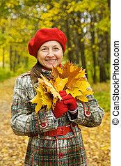 Portrait of senior woman in autumn - Portrait of senior...