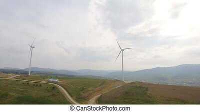 Aerial drone view on Wind Turbine, Windmill, Energy Production in mountains