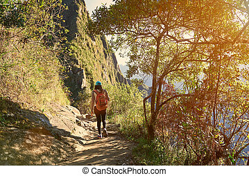Hiking in mounatin landscape on sunny day light. Active...