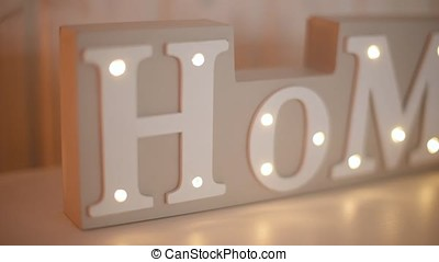"the letters in the word ""Home"""