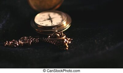 Antique Gold Pocket Watch close to camera motion
