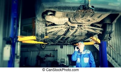 Mechanic talking with new customer with serious problems of car.