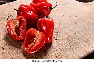 Fresh habanero peppers on wooden background