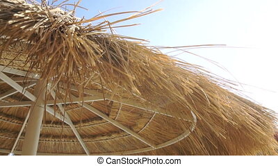 straw Sun umbrella on a bright sunny day