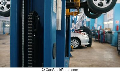Mechanic works in the automotive service, slider, close up