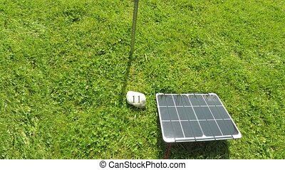 Concept of renewable energy by showing a sundial powering...