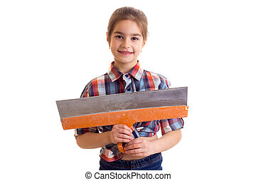Little girl holding putty knife - Little smiling girl with...