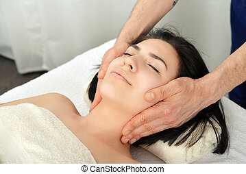 Head massage - Young attractive woman getting head massage...