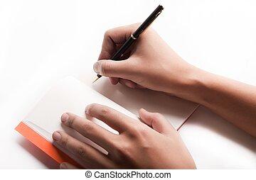 pen is being held in hand