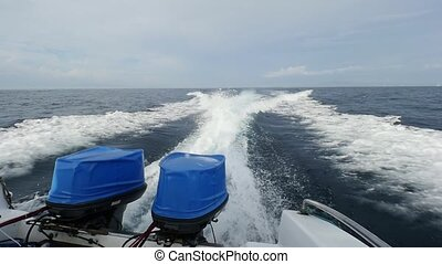 Motor boats on a background of waves and sea foam.