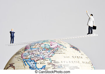 Business figurines and earth globe - Business figures placed...