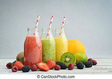 Fruit smoothies in retro bottles with strawberry, kiwi,...
