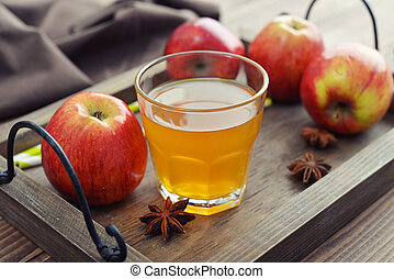 Apple cider in glass with fresh apples on wooden vintage...