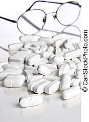 Reading glasses and pills