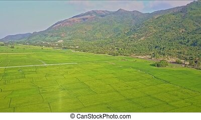 Aerial View Over Rice Field Landscape with Road by Mountains...