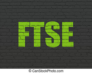 Stock market indexes concept: FTSE on wall background -...