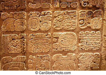 Mayan hieroglyphs carved on the lime stone
