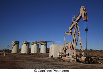 Oil Well - Oil well in the desert with blue sky