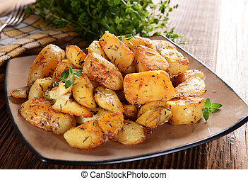 Fried potatoes with rosemary and thyme