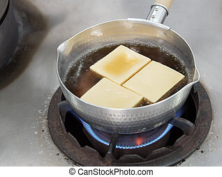 Cooking with Tofu in dashi boil for soup