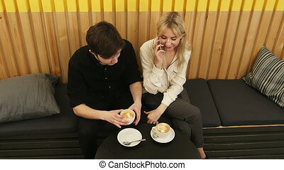 Young cheerful woman talking via cell phone, while dating in...