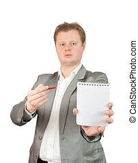 Businessman pointing at blank notebook - Businessman in...