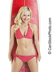 Happy sexy young woman in red bikini with a surfboard against white background