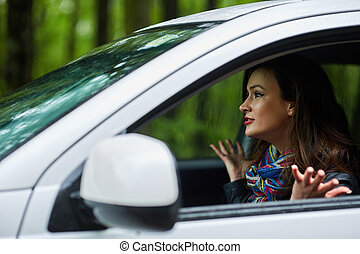 Angry woman with road rage - Angry woman driver with road...