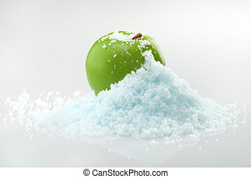 Apple in snow - Green delicious Christmas apple in snow with...